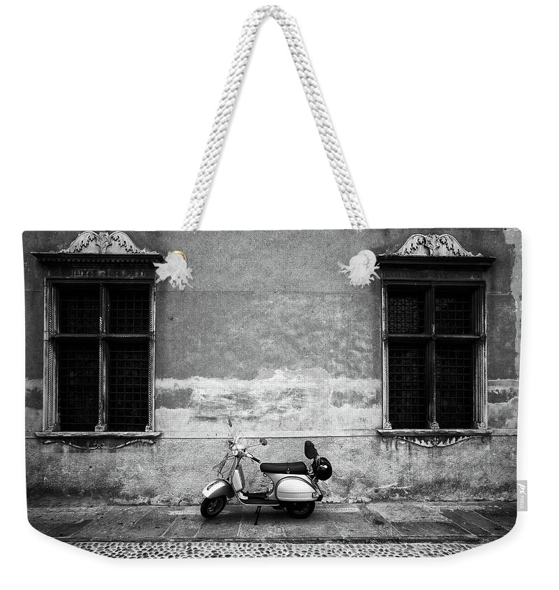 Two Objects Weekender Tote Bag featuring the photograph Vespa Piaggio. Black And White by Claudio.arnese