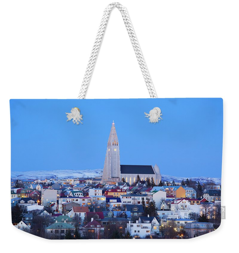 Snow Weekender Tote Bag featuring the photograph View Of Hallgrimskirkja Church by Travelpix Ltd