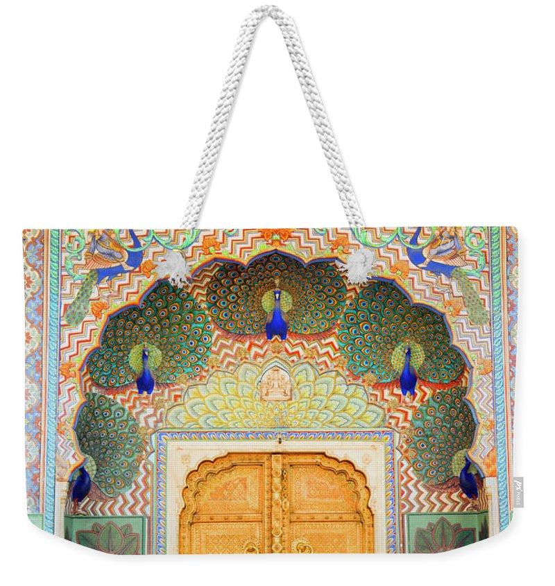 Arch Weekender Tote Bag featuring the photograph View Of Peacock Door In Palace by Grant Faint