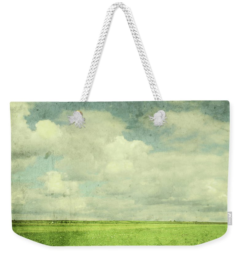 Scenics Weekender Tote Bag featuring the photograph Vintage Image Of Green Field And Blue by Jasmina007
