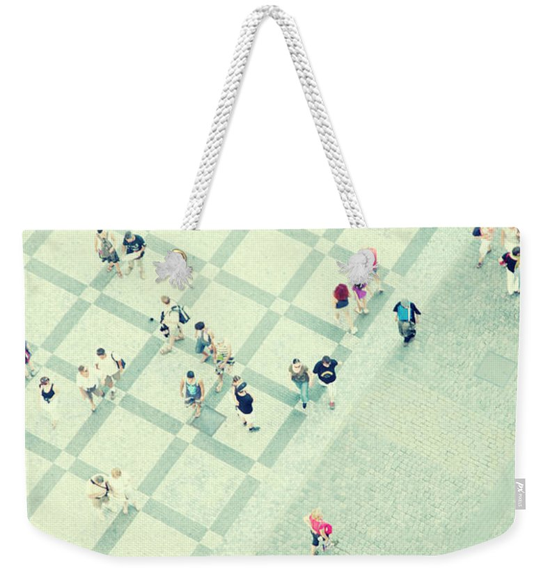 Pedestrian Weekender Tote Bag featuring the photograph Walking People by Carlo A