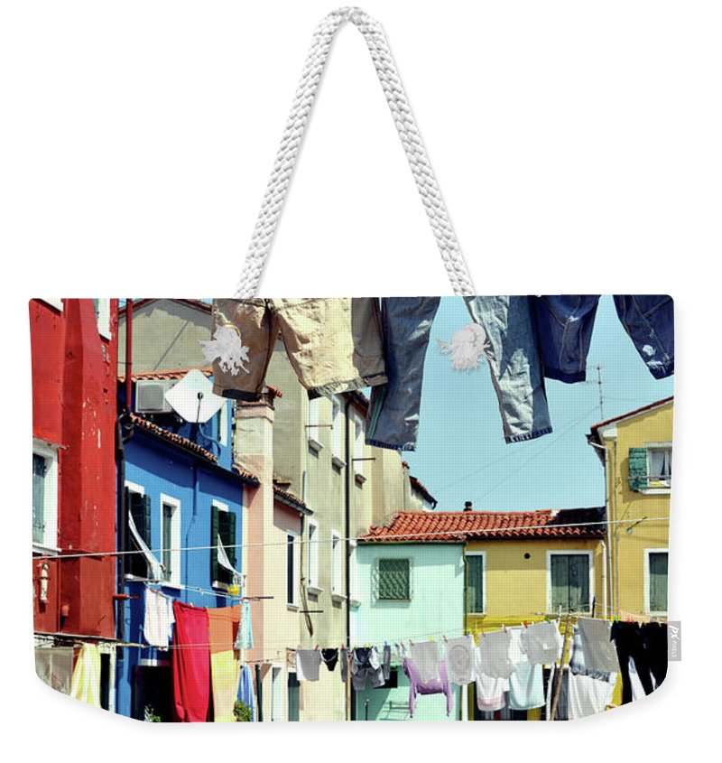 Hanging Weekender Tote Bag featuring the photograph Washday In Burano by Paul Biris