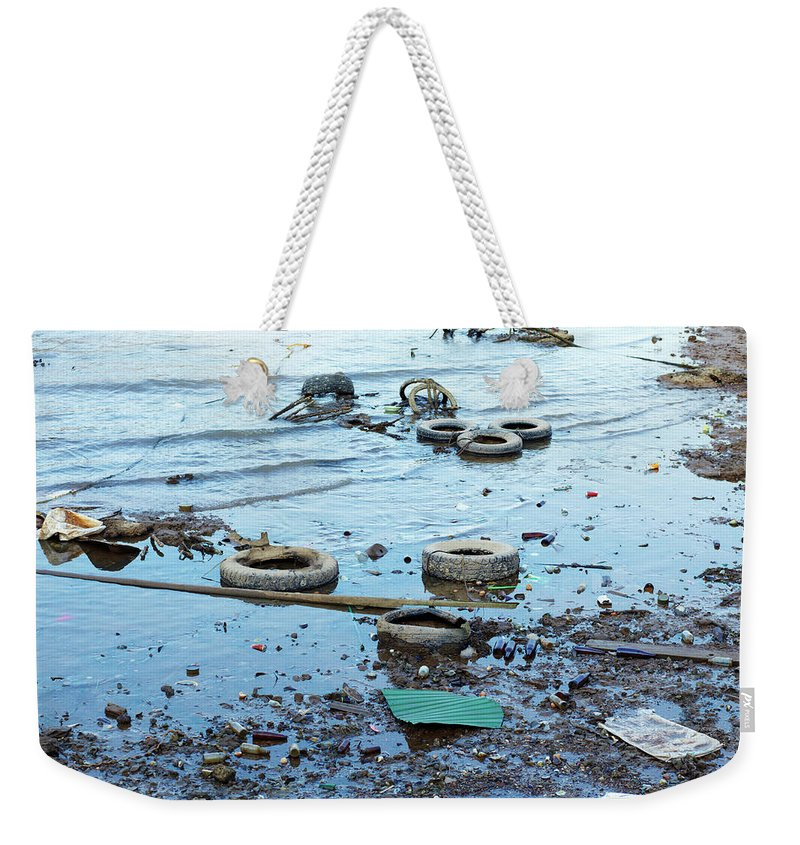 Water's Edge Weekender Tote Bag featuring the photograph Water Pollution by Drbouz