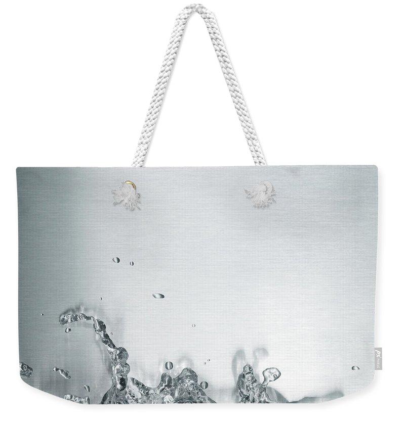 Underwater Weekender Tote Bag featuring the photograph Water Splash by Plainview