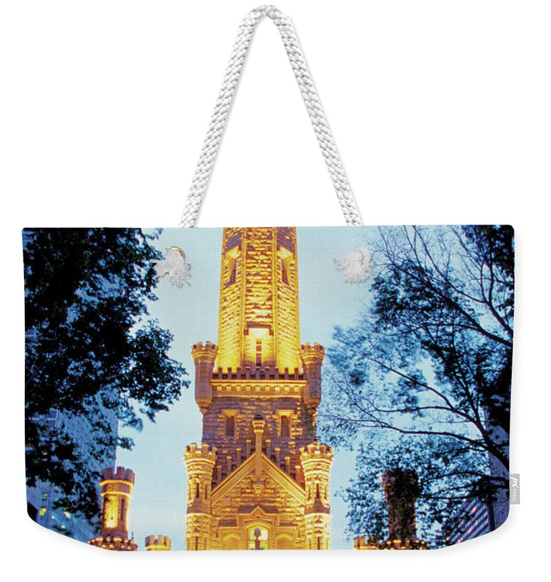 Travel16 Weekender Tote Bag featuring the photograph Water Tower At Night In Chicago by Medioimages/photodisc