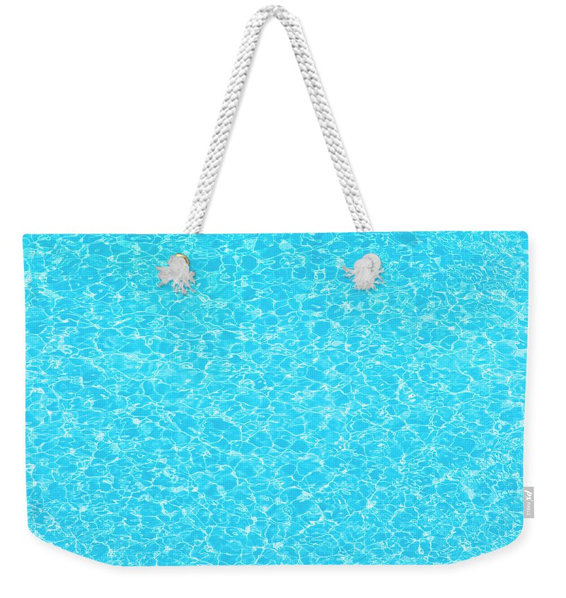 Cool Attitude Weekender Tote Bag featuring the photograph Water Wave Pattern Of Swimming Pool by Anddraw