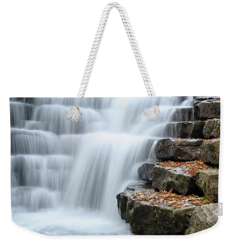 Steps Weekender Tote Bag featuring the photograph Waterfall Flowing Over Rock Stair by Catnap72