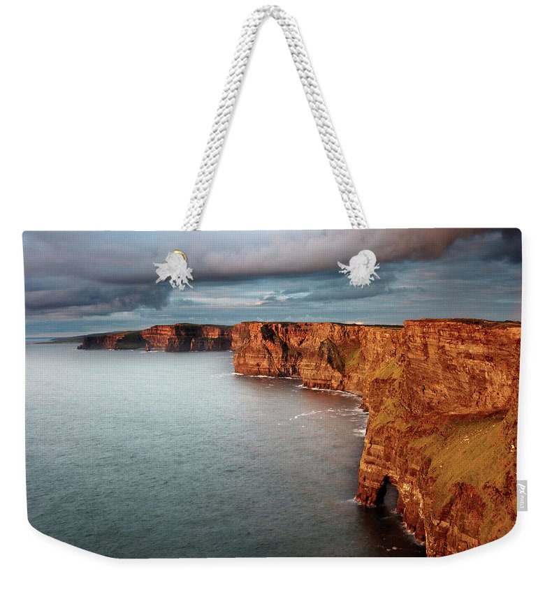 Scenics Weekender Tote Bag featuring the photograph Waves Washing Up On Rocky Cliffs by George Karbus Photography