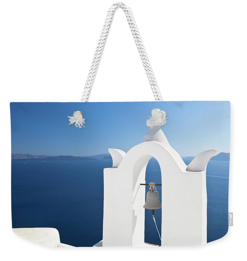 Greek Culture Weekender Tote Bag featuring the photograph White Bell Tower And Blue Sea by Michaelutech
