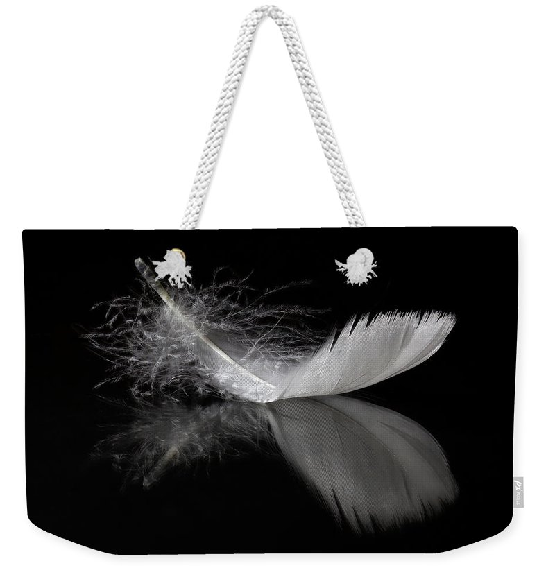 Feather Weekender Tote Bag featuring the photograph White Feather Reflection by Tom Mc Nemar