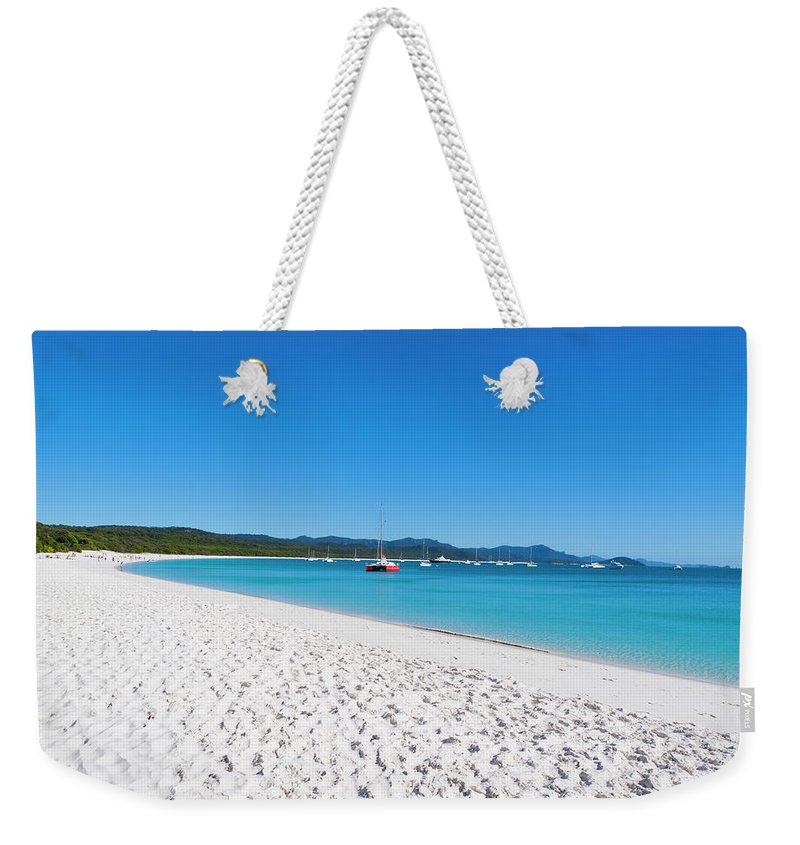 Clear Sky Weekender Tote Bag featuring the photograph Whitehaven Beach On Whitsunday Island by Holgs