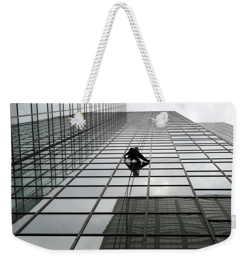 Working Weekender Tote Bag featuring the photograph Window Washer by Filo