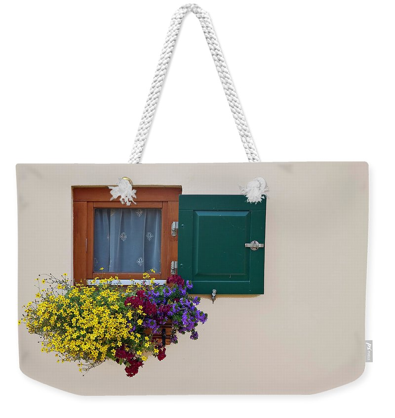 Outdoors Weekender Tote Bag featuring the photograph Window With Flowers by Enzo D.