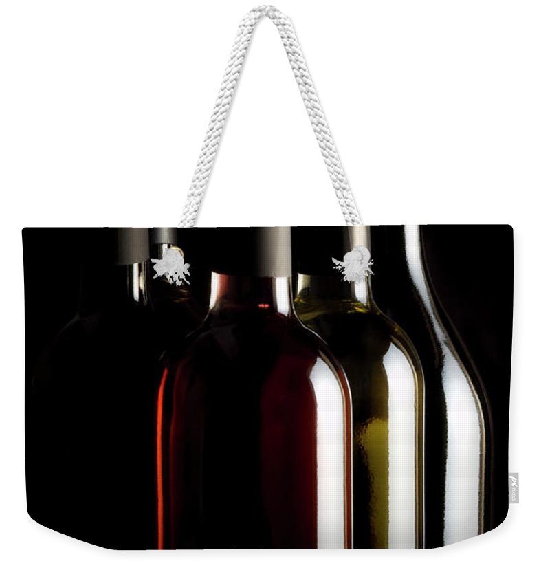 Rose Wine Weekender Tote Bag featuring the photograph Wine Bottles by Carlosalvarez