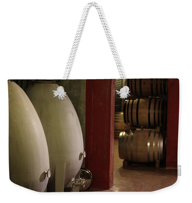 Aging Process Weekender Tote Bag featuring the photograph Wine Cellar by Tom And Steve