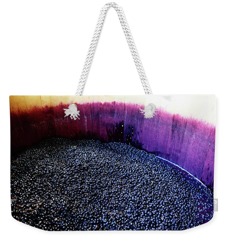Working Weekender Tote Bag featuring the photograph Wine Grapes Ready For Pressing In by Rapideye
