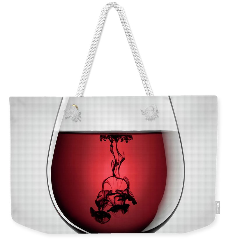 Shadow Weekender Tote Bag featuring the photograph Wineglass, Red Wine And Black Ink by Thomasvogel