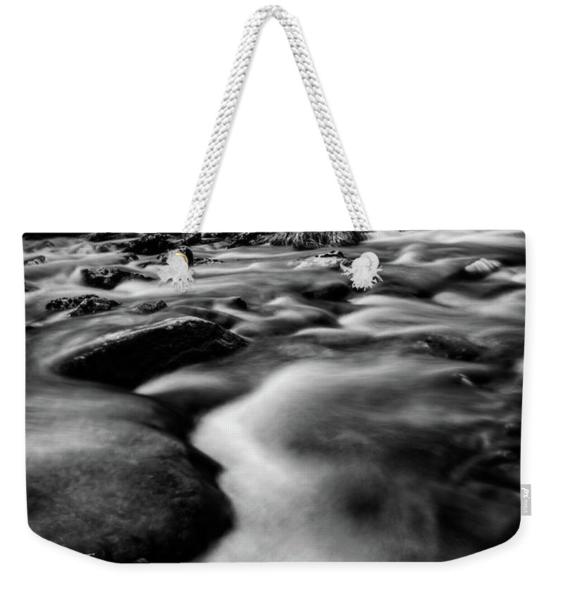 Welsh Mountain Weekender Tote Bag featuring the photograph Winter Rapids Snowdonia by Adrian Evans