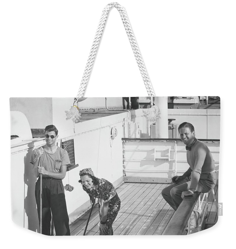 Young Men Weekender Tote Bag featuring the photograph Woman And Two Men On Cruiser Deck, B&w by George Marks