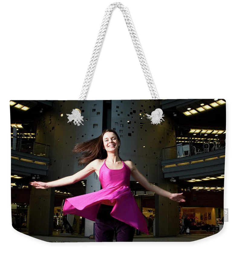 People Weekender Tote Bag featuring the photograph Woman Dancing In Old Brewery Shopping by Tim E White