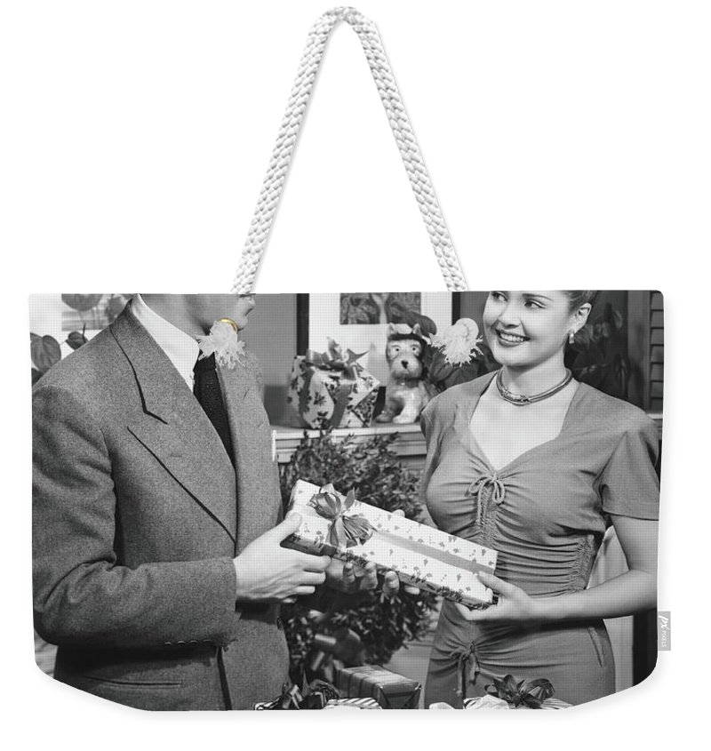 Heterosexual Couple Weekender Tote Bag featuring the photograph Woman Giving Gift To Man, B&w by George Marks
