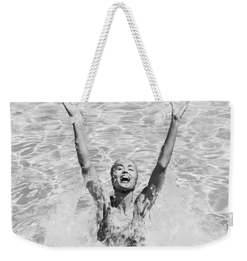 Human Arm Weekender Tote Bag featuring the photograph Woman Having Fun In Swimming Pool by Tom Kelley Archive