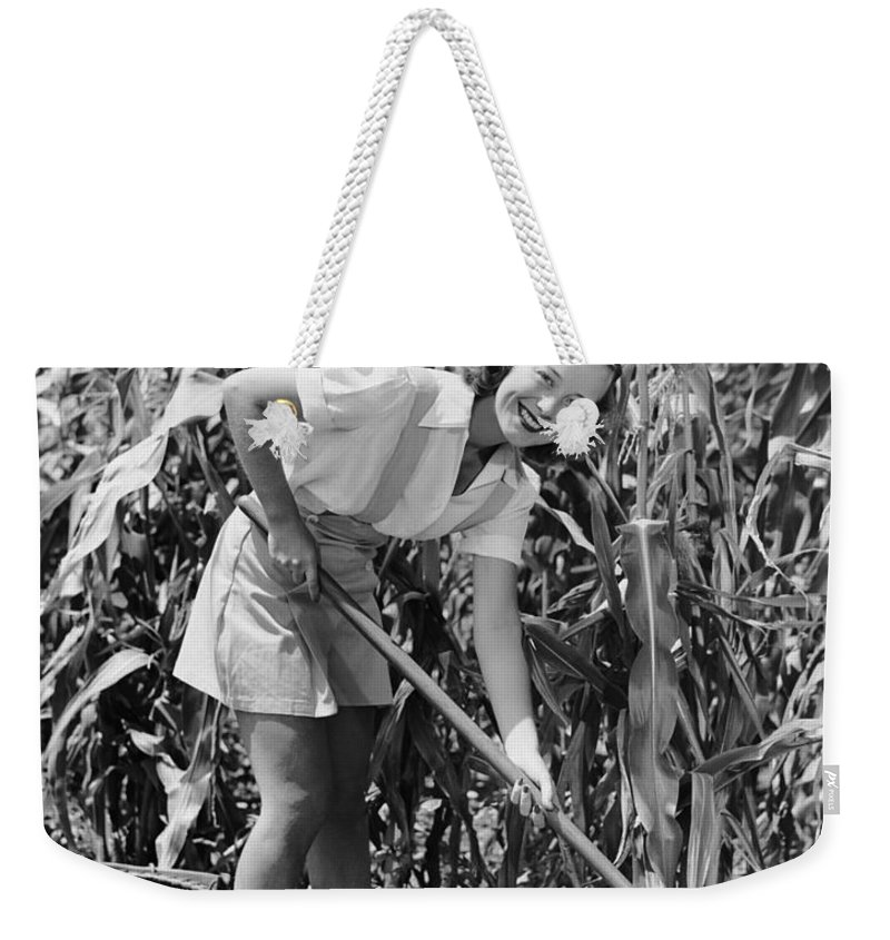 Farm Worker Weekender Tote Bag featuring the photograph Woman Hoeing In Field Of Corn by George Marks