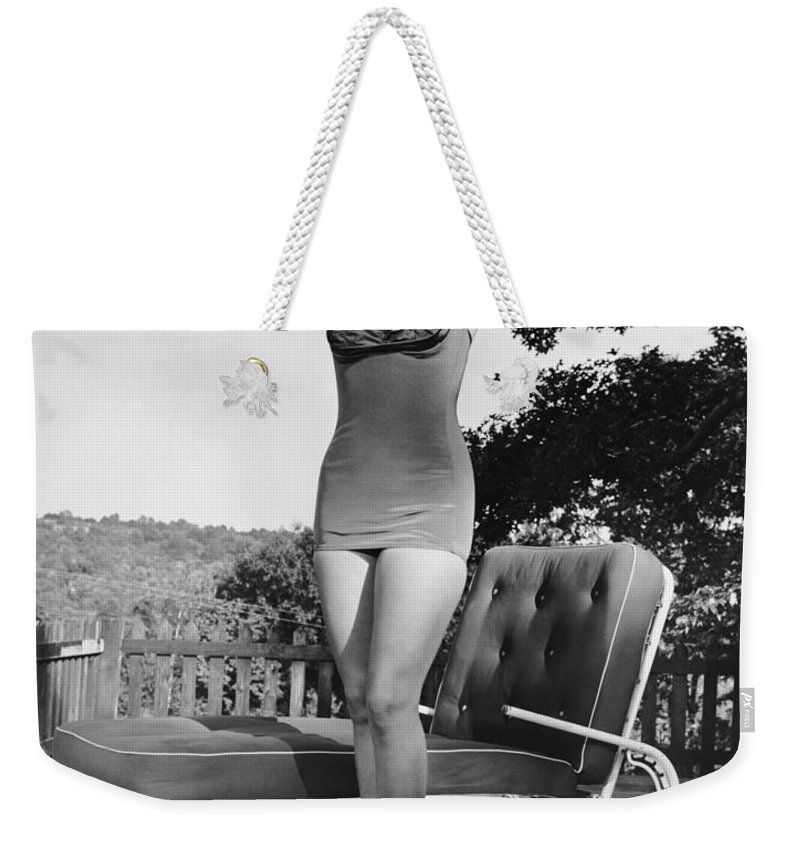 People Weekender Tote Bag featuring the photograph Woman In Bathing Suit Outdoors by George Marks
