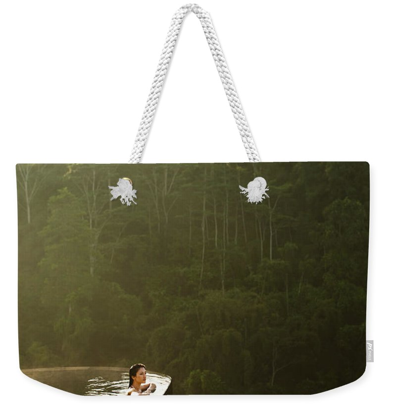 Tropical Rainforest Weekender Tote Bag featuring the photograph Woman In Infinity Pool At Sunrise. Bali by Matthew Wakem