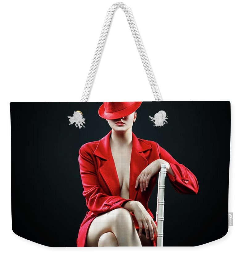 Woman Weekender Tote Bag featuring the photograph Woman In Red by Johan Swanepoel