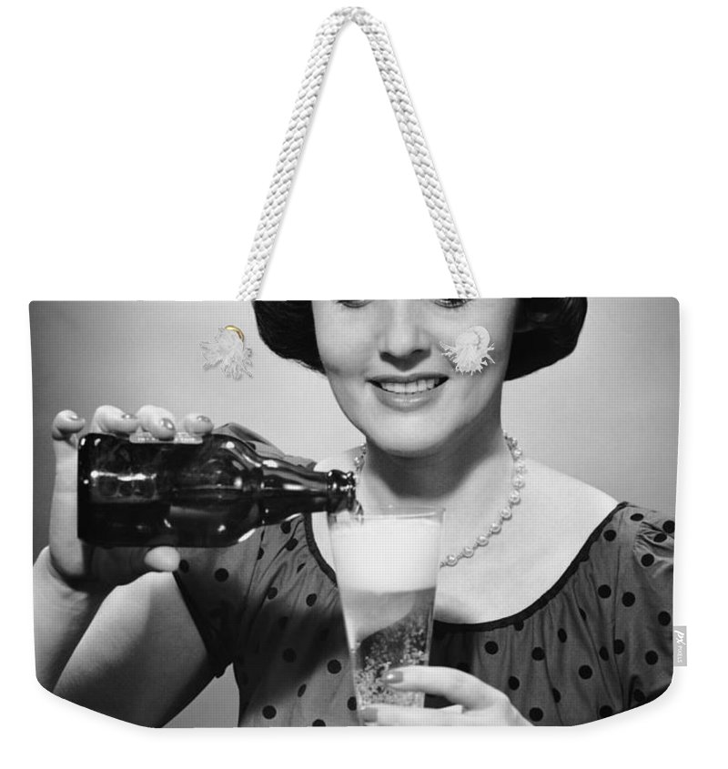 People Weekender Tote Bag featuring the photograph Woman Pouring Alcoholic Beverage by George Marks