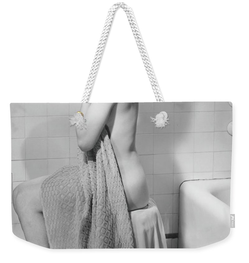 Looking Over Shoulder Weekender Tote Bag featuring the photograph Woman Sitting In Bathroom, Covering by George Marks