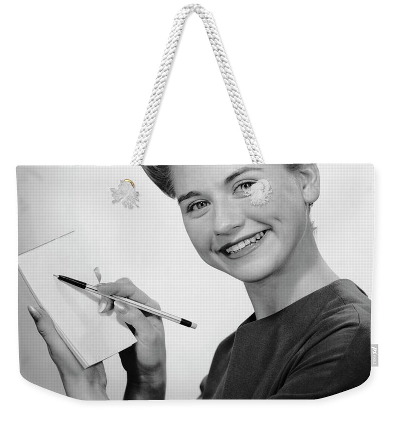 People Weekender Tote Bag featuring the photograph Woman Smiling Wpen & Pad by George Marks