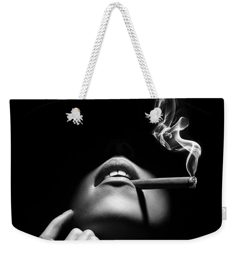 Woman Weekender Tote Bag featuring the photograph Woman smoking a cigar by Johan Swanepoel