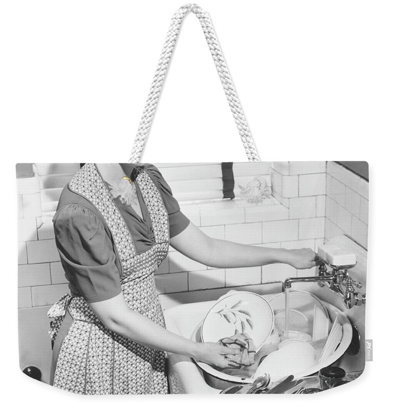 Three Quarter Length Weekender Tote Bag featuring the photograph Woman Washing Dishes In Kitchen Sink by George Marks