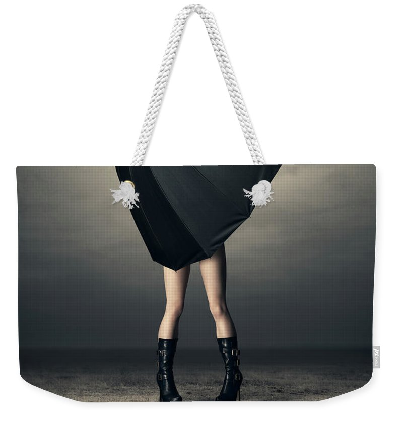 Woman Weekender Tote Bag featuring the photograph Woman With Huge Umbrella by Johan Swanepoel