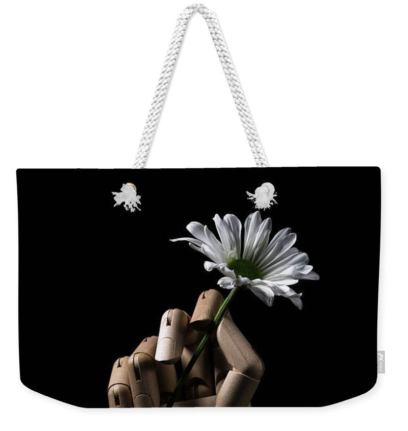 Daisy Weekender Tote Bag featuring the photograph Wooden Hand Holding Flower by Edward Fielding