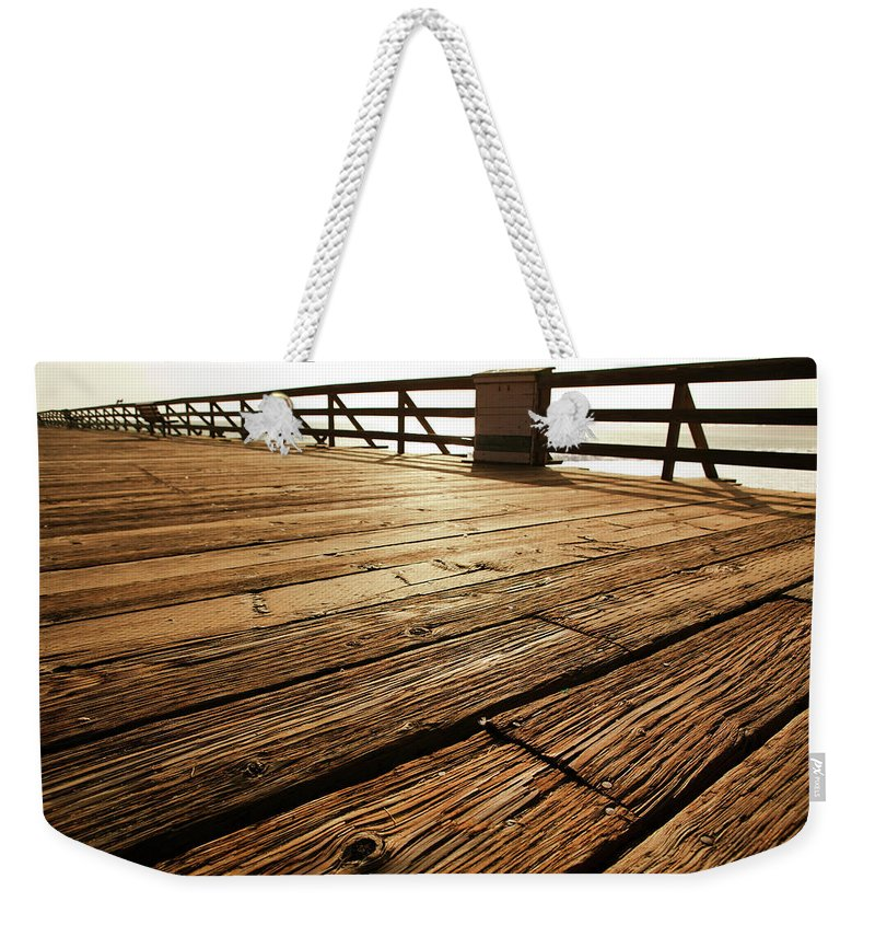 Scenics Weekender Tote Bag featuring the photograph Wooden Pier by Timnewman