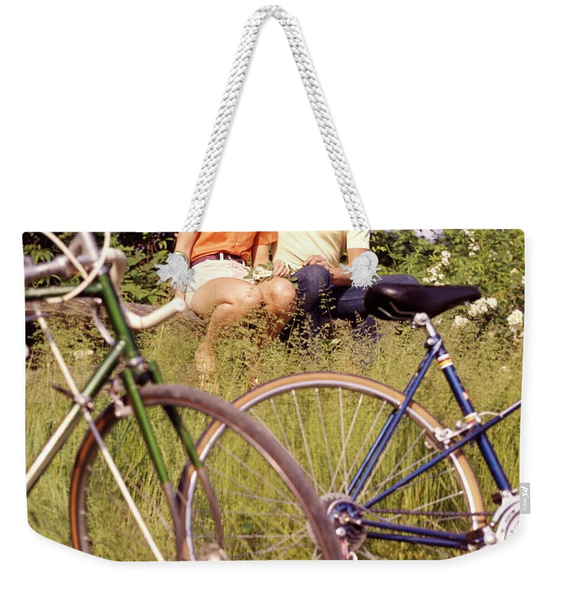 Heterosexual Couple Weekender Tote Bag featuring the photograph Young Adults Teenagers Field Date Bikes by H. Armstrong Roberts