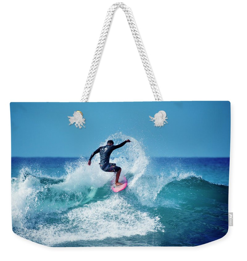 Young Men Weekender Tote Bag featuring the photograph Young Male Surfer Surfing In The Water by Yinyang