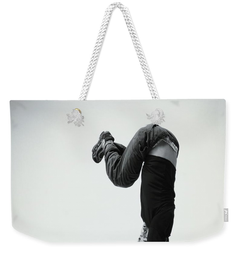Youth Culture Weekender Tote Bag featuring the photograph Young Man Breakdancing B&w by Karen Moskowitz