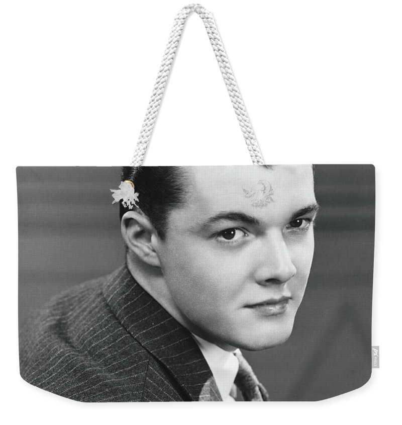 Young Men Weekender Tote Bag featuring the photograph Young Man Wearing Pinstripe Jacket by George Marks