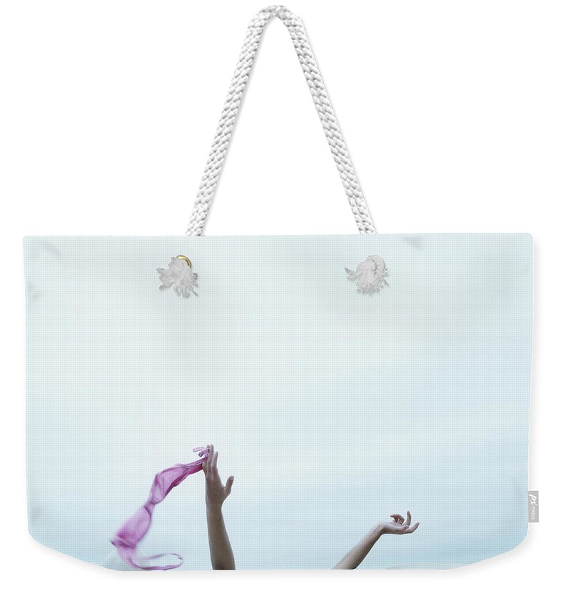 Young Men Weekender Tote Bag featuring the photograph Young Woman In Convertible Car, Arms by Jerome Tisne