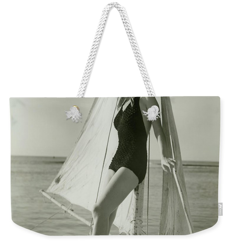 Human Arm Weekender Tote Bag featuring the photograph Young Woman Posing On Sailboat by George Marks