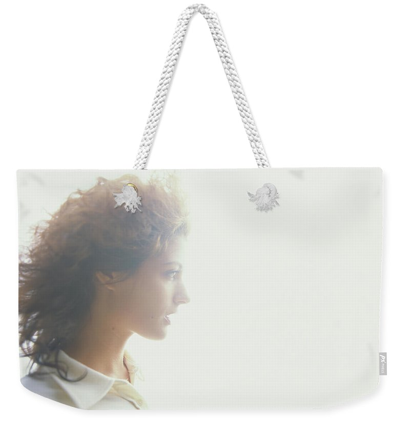 Beautiful Woman Weekender Tote Bag featuring the photograph Young Woman, Profile Soft Focus by Thomas Barwick