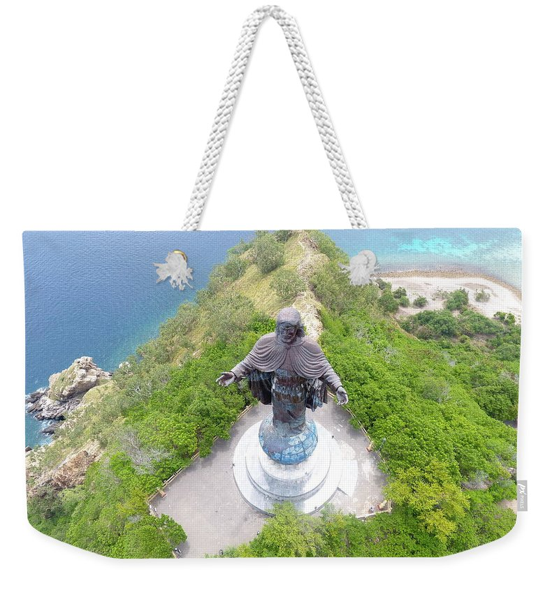 Travel Weekender Tote Bag featuring the photograph Cristo Rei of Dili statue of Jesus by Brthrjhn2099