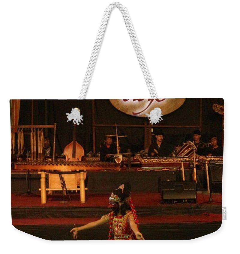 Dance Weekender Tote Bag featuring the photograph Mask Dance by Lingga Tiara Setiadi