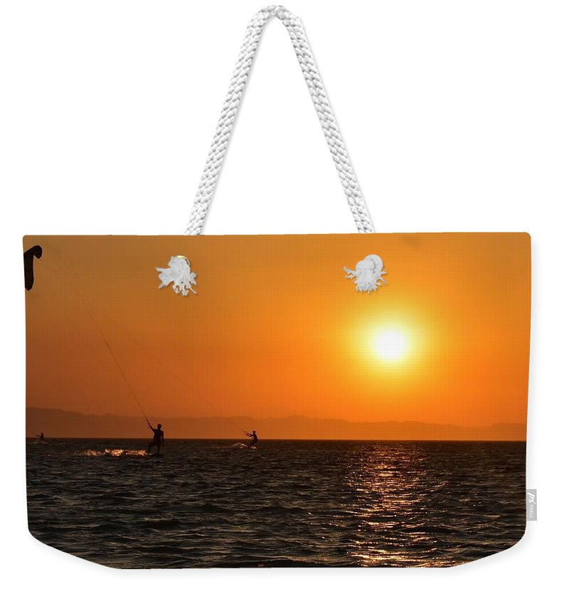 Kitesurfing Weekender Tote Bag featuring the photograph Red sea sunset by Luca Lautenschlaeger