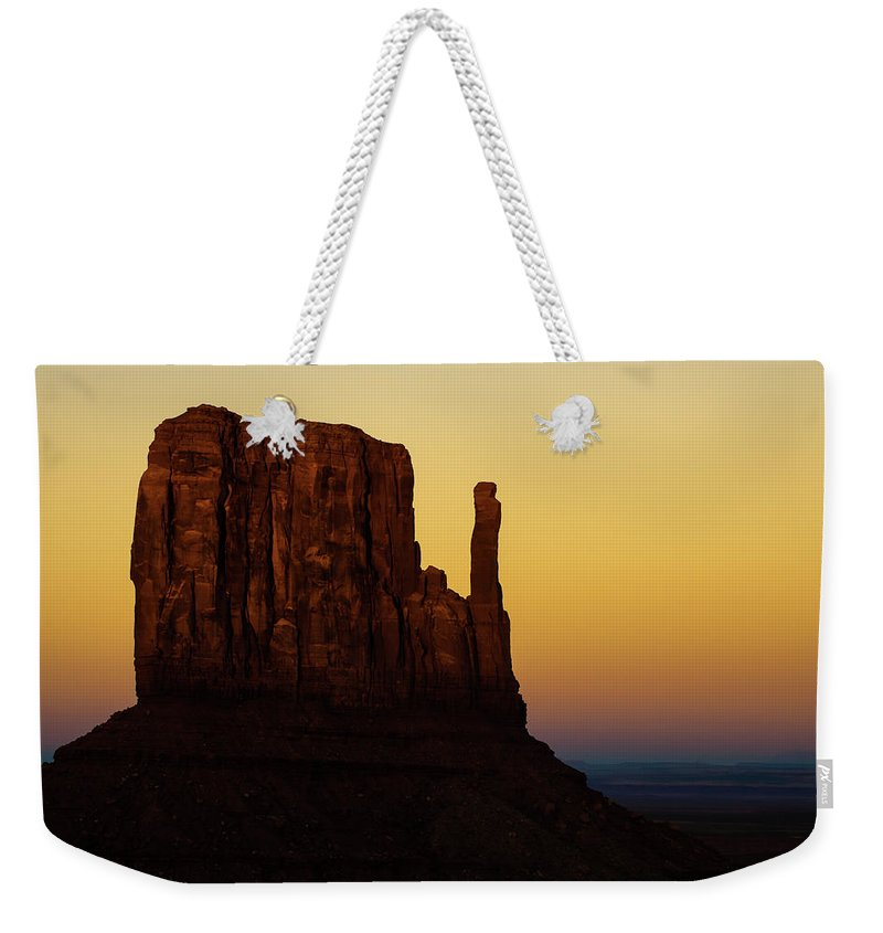 America Weekender Tote Bag featuring the photograph A Monument of Stone - Monument Valley Tribal Park by Gregory Ballos