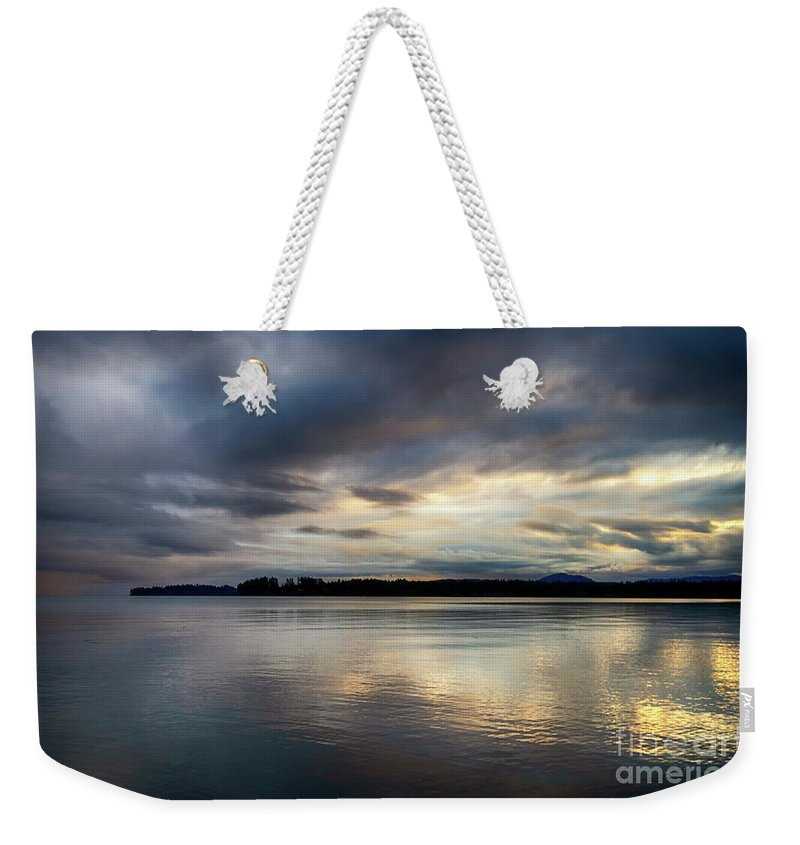 Sunrise Weekender Tote Bag featuring the photograph A Point Of Land by Bob Christopher